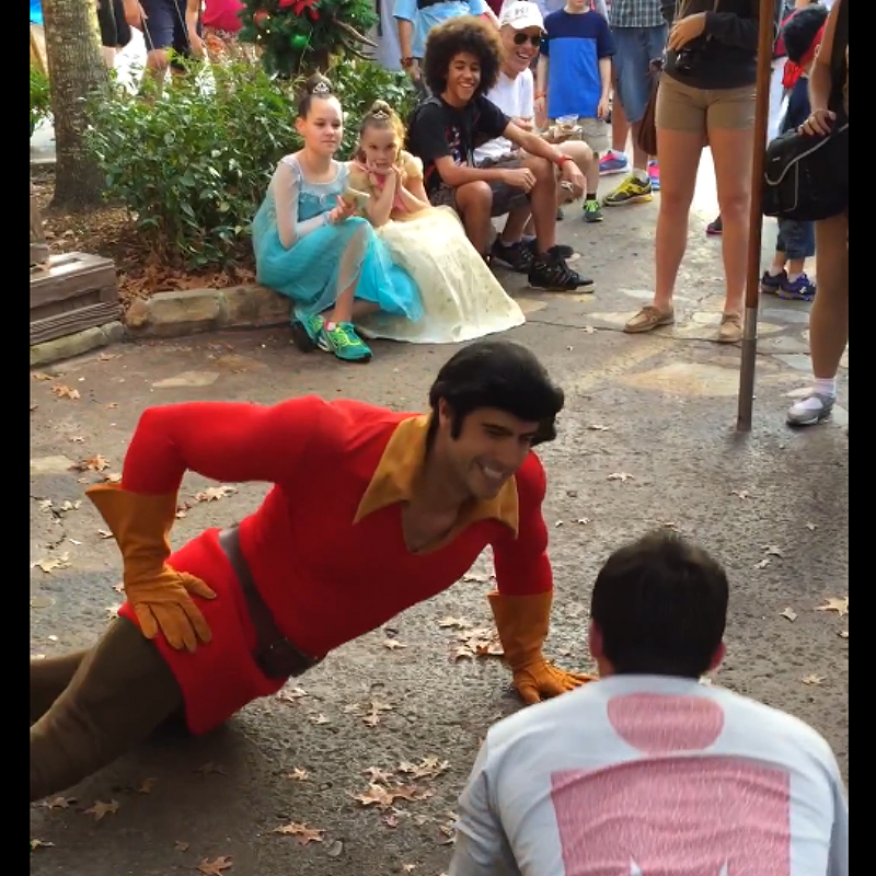 Be our guest and watch this dude challenge Gaston to a push-up contest