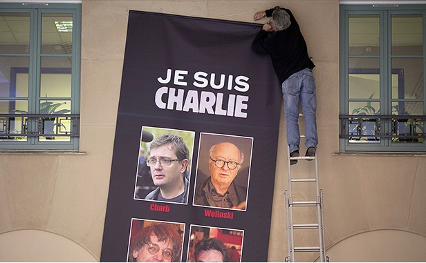 Charlie Hebdo's defiant, emotional return