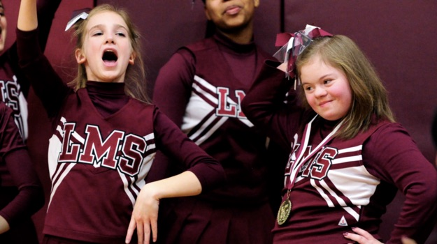 Middle school basketball players defend a bullied cheerleader in the most perfect way