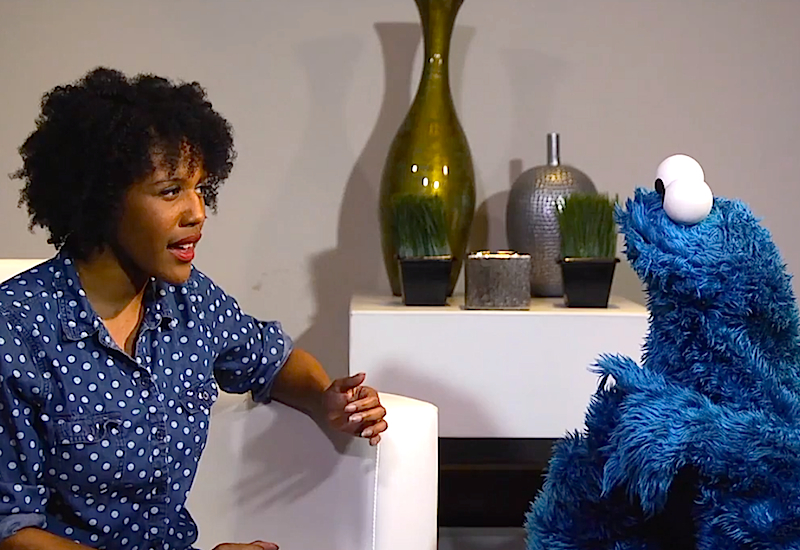Cookie Monster, life coach, helps adults with their real problems using cookies!