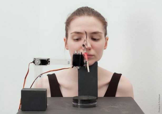 This makeup-doing robot is out to prove a point — and it's not what you'd think