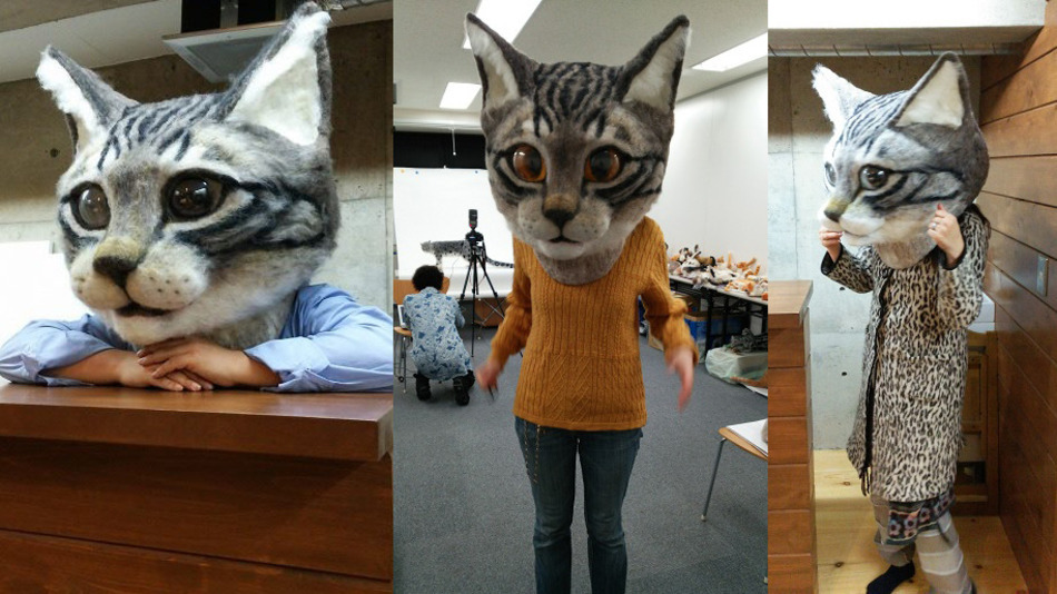 OMG this giant, realistic cat head is equal parts cute and terrifying