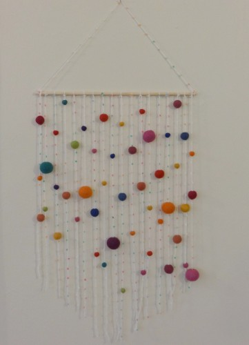 Dress up your space with this DIY pompom wall hanging