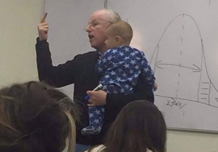 Why that photo of a professor holding a baby has gone completely viral