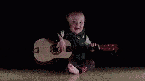 This 8-month old baby genius can play every rock and roll instrument