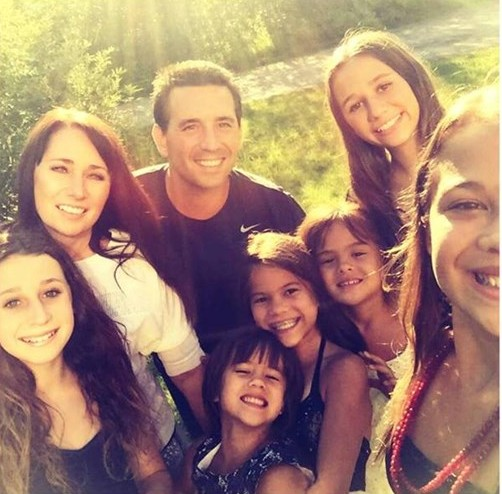 After her best friend died of cancer, this woman adopted her four daughters