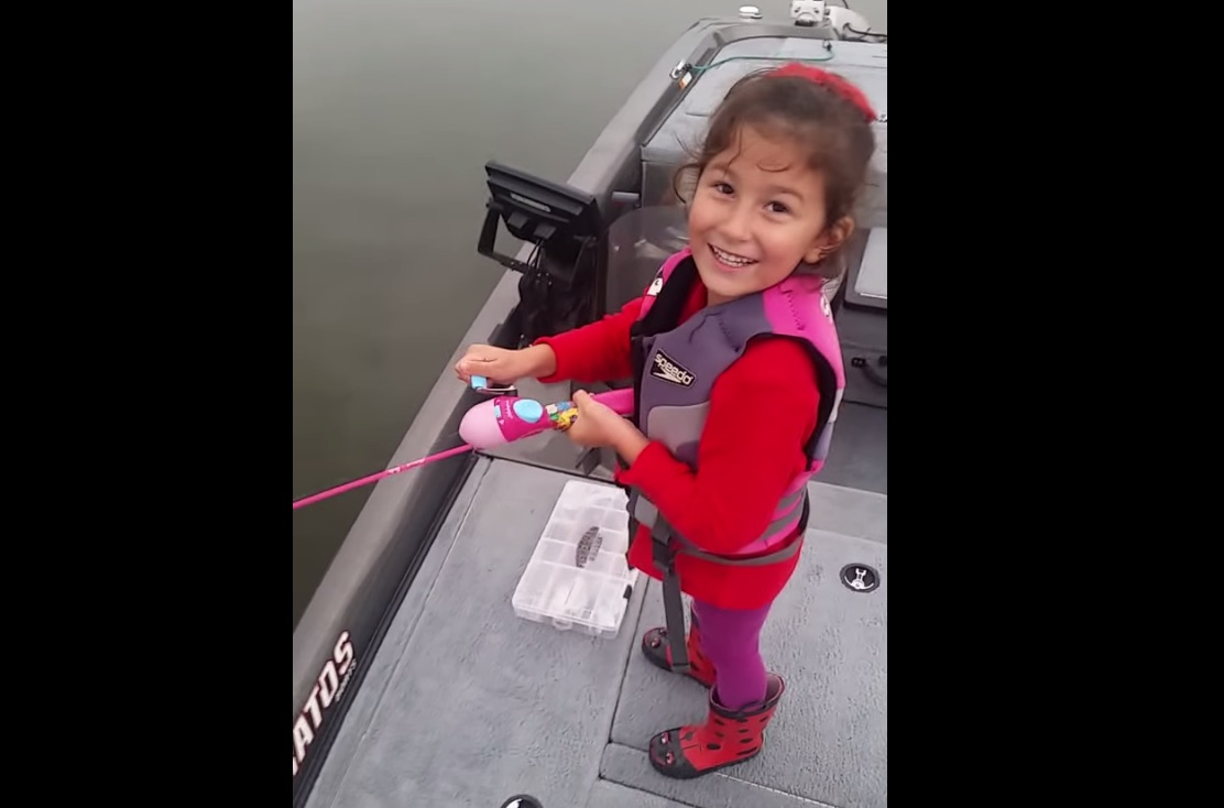 Little girl catches monster fish with Barbie fishing pole, blows her dad's mind