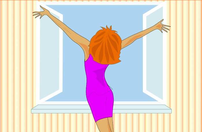 Girl standing at the window in the morning and glad hands outstretched