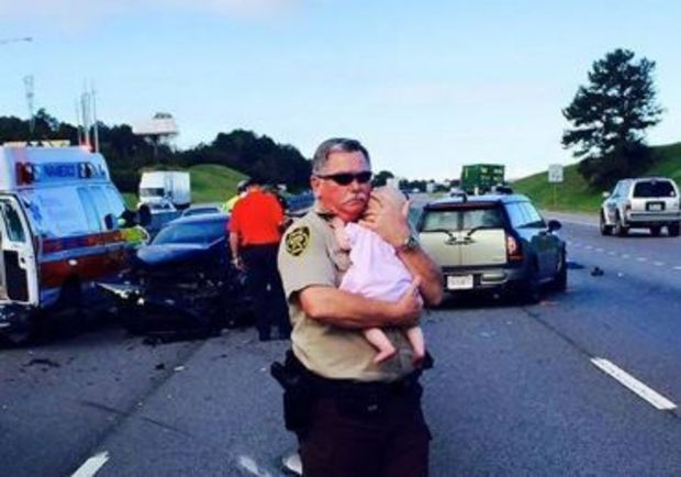 Why this sweet picture of a policeman and a baby just went viral