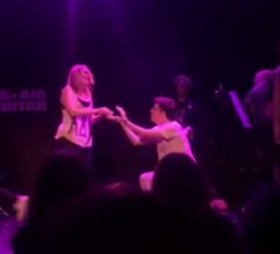 I got engaged at an air guitar competition—and it was perfect