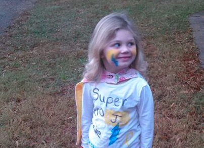 This little girl dressed as a hero for Halloween — herself