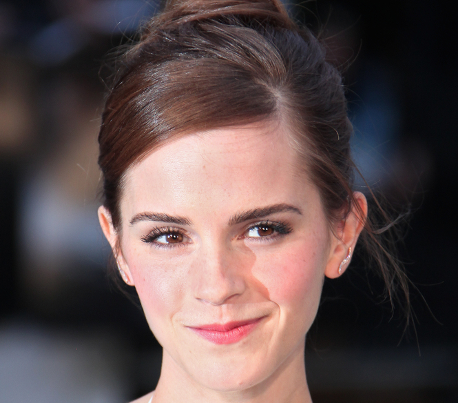 Emma Watson's a little embarrassed by these adorable 'Harry Potter' photos