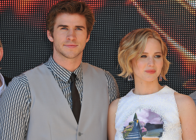 Liam Hemsworth carries J-Law's purse across the Great Wall of China, we melt