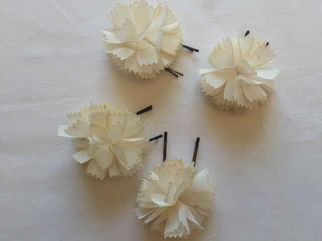 Add some extra cute to your holiday look with these DIY flower hair pins