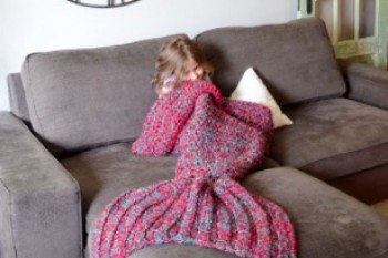 Mermaid tail blankets have just moved to the top of our wish list