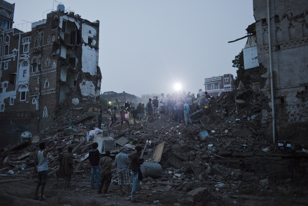 Yemeni men attempt to dig their neighbors from the rubble of a Saudi coalition airstrike on Old Sana'a on June 12, 2015 in Sana'a, Yemen. The strike flattened five of the historical homes and killed five people from one family, thankfully the other homes had already been evacuated.