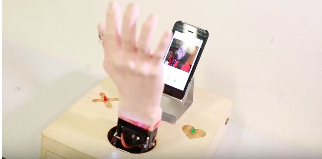 This telepathic robot hand is the best new way to use Tinder