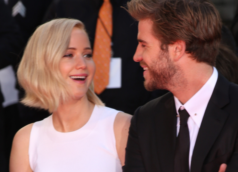 J.Law admits to kissing Liam Hemsworth off camera. We're swooning.