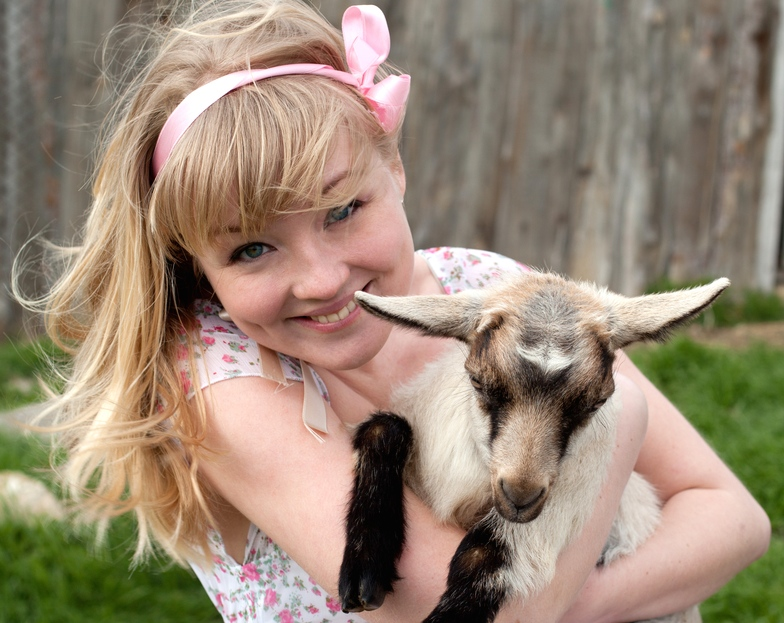 Cuddling baby goats is a job, and they're hiring