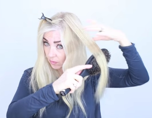 You will freak out over the magical way this woman uses a straightening iron