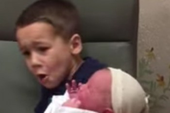 This boy's reaction to a screaming baby is the one we all have on the inside