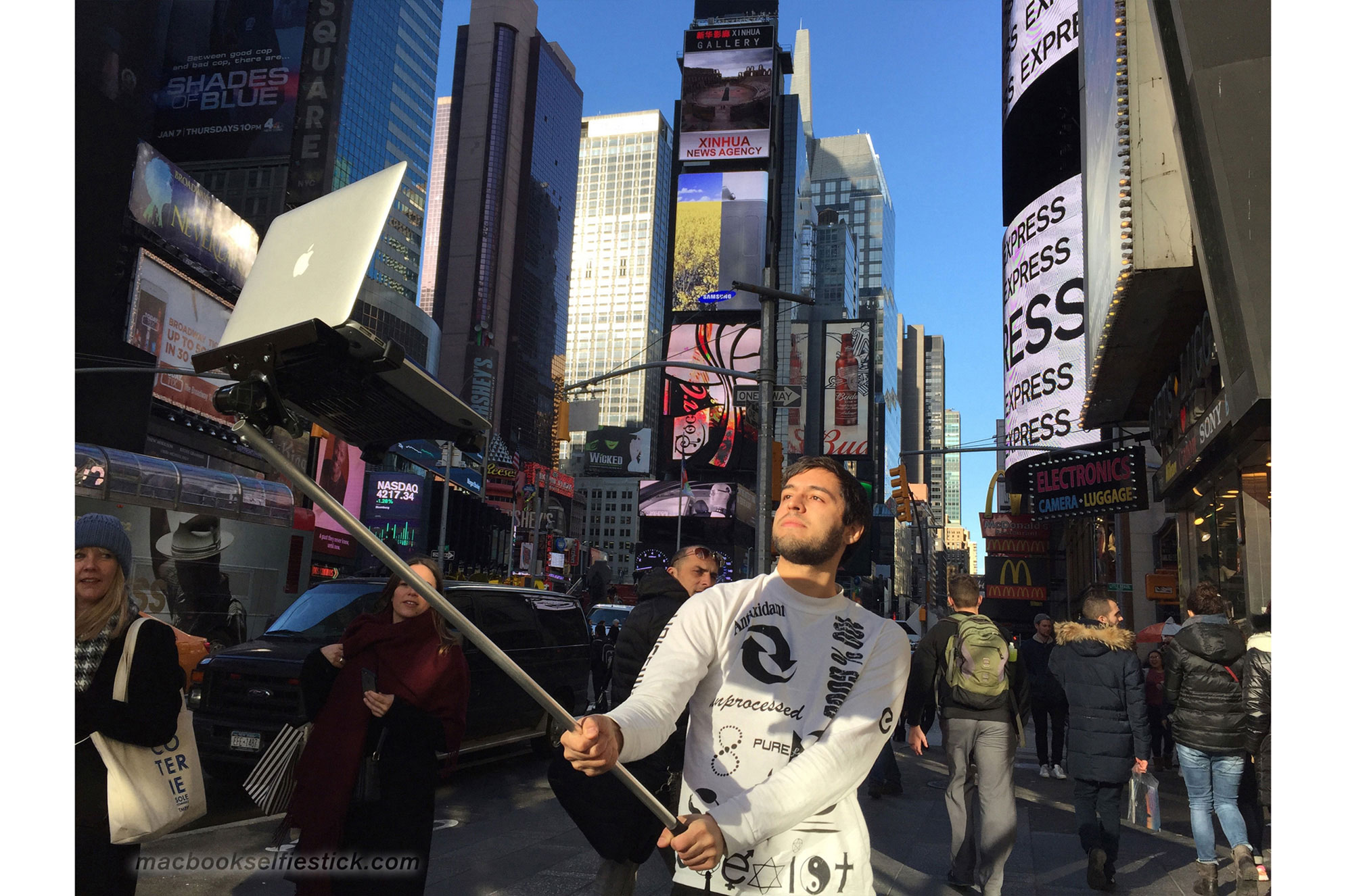 This Macbook selfie stick is a real thing we didn't seeing coming