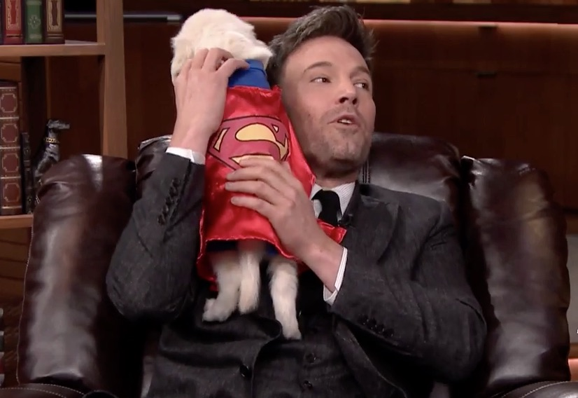 Ben Affleck cuddling puppies dressed like superheroes is all we need in life
