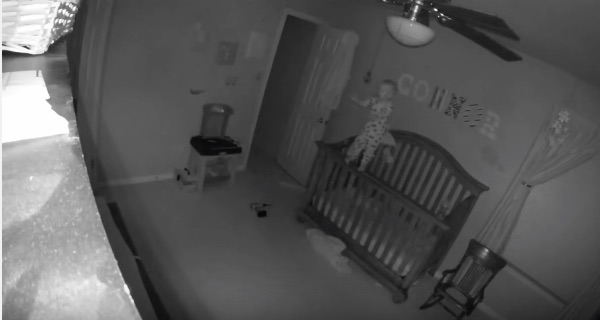 This baby eerily balances on the edge of his crib and it's freaking people out