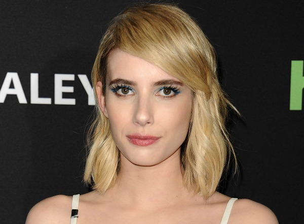 Emma Roberts channels some serious '90s vampire nostalgia in this red velvet dress