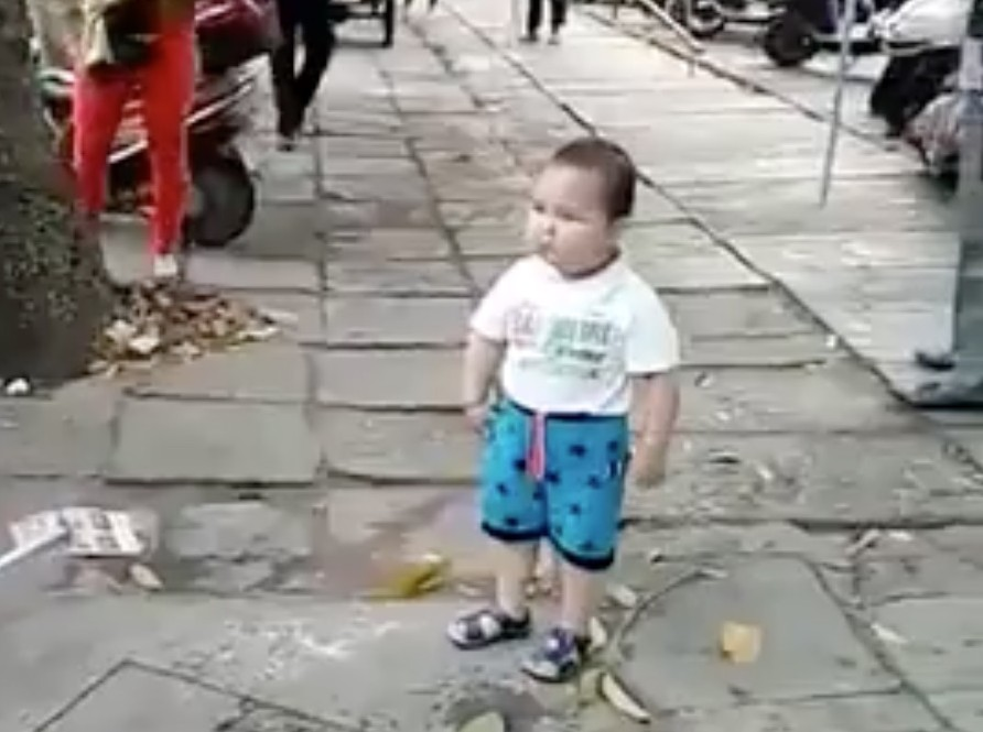 This toddler is very serious about defending his grandma
