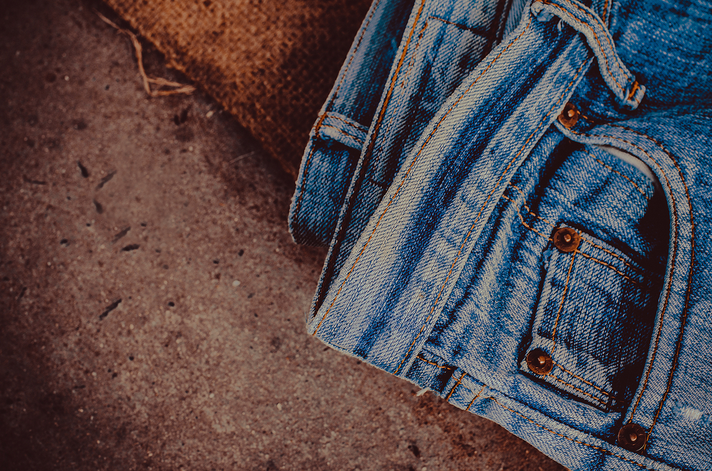 Here's the actual reason your jeans have those random little silver buttons on the pockets