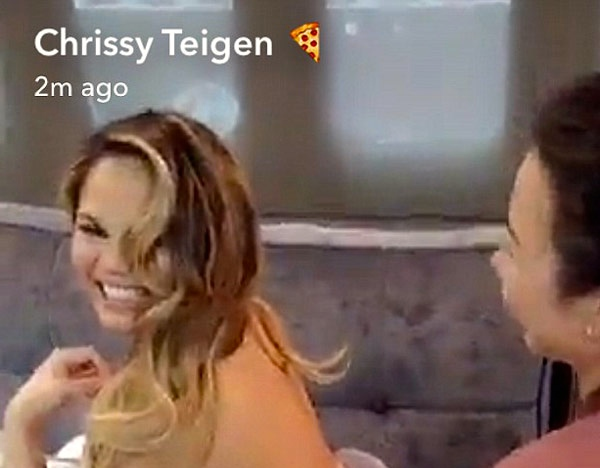 Chrissy Teigen casually breastfeeds during a photoshoot, is our hero