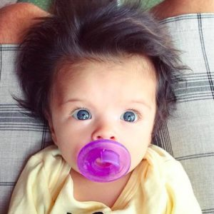 This adorable two-month-old baby has a more impressive head of hair than most adults