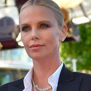 Charlize Theron just destroyed the red carpet at Cannes in a friggin' tuxedo