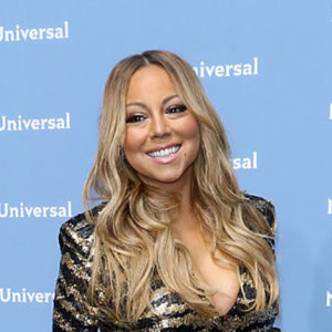 Watch Mariah Carey put on stilettos with the help of FOUR people