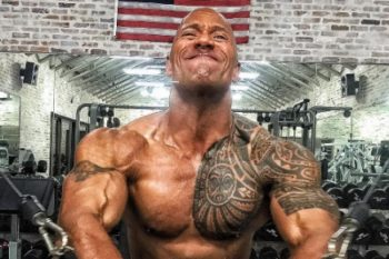 The Rock's daughter is adorably obsessed with his tattoos