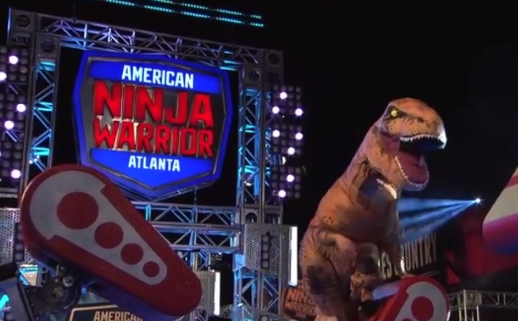 """This guy in a dino suit on """"American Ninja Warrior"""" is exactly what we need in the world right now"""