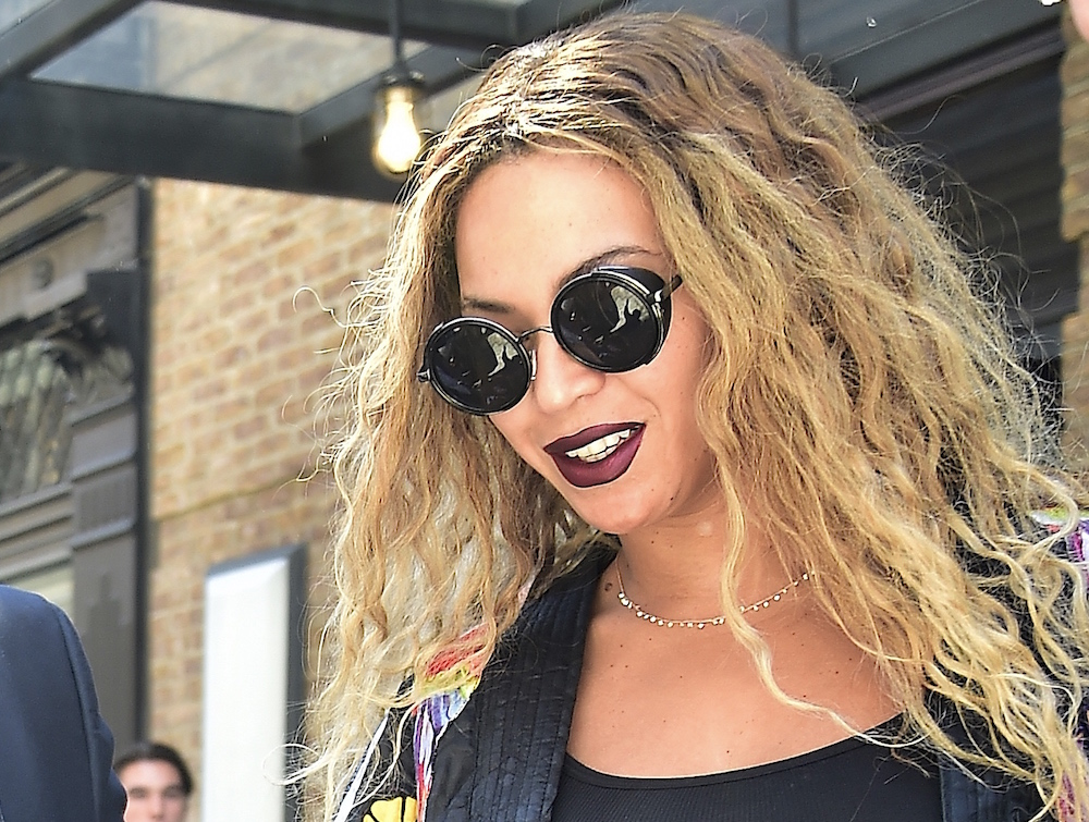 Beyoncé proves why you should own a tube of gothic red lipstick for summer