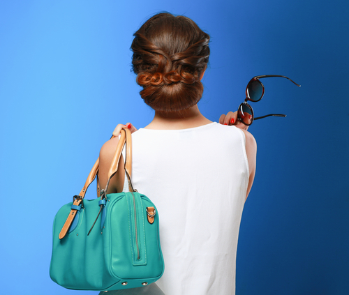 The way you wear your purse might be wrecking your hair