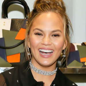 Chrissy Teigen rocked the heck out of Disney's Mickey ear bag