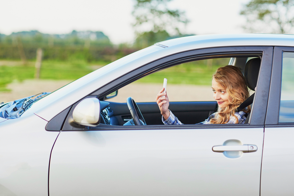 Please, please don't take driving selfies (because a lot of people are)