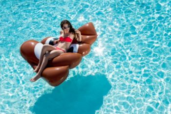 Summer doesn't officially begin until you have a poop emoji pool float to sunbathe on