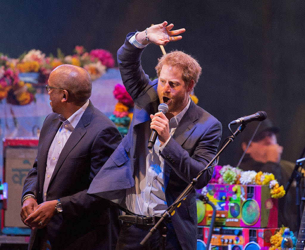 Prince Harry is all of us rocking out onstage at a Coldplay concert