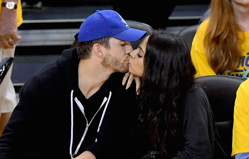 Ooh la la: Mila Kunis remembers the night she took things to the ​~next level~​ with Ashton Kutcher