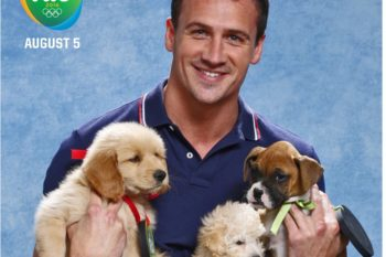 Here are some Olympians cuddling with puppies to make your day perfect