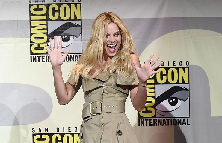 We want to steal EVERY PART of Margot Robbie's incredible trench coat dress