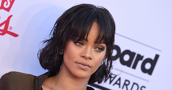 Rihanna gets dreadlocks, reminds us that she's the queen of all things stylish AND good in the world