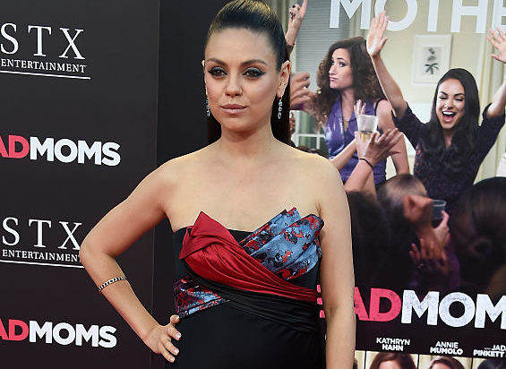 Mila Kunis looks like she's going to a high-fashion garden party and we're low key obsessed