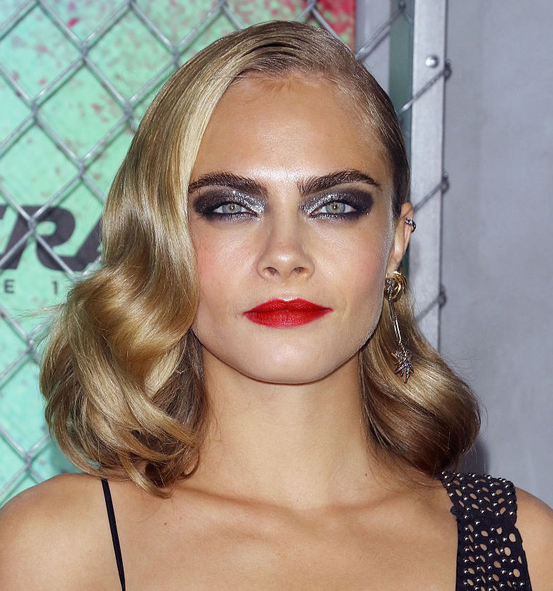 Cara Delevingne looks like a modern-day Wednesday Addams in this blood red dress