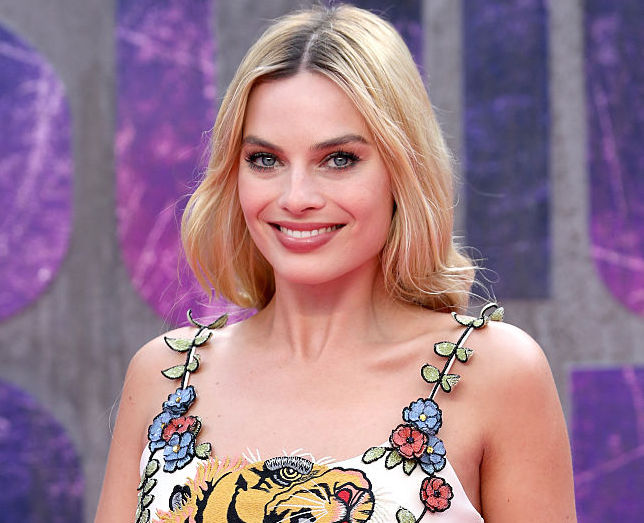 Margot Robbie looks like a jungle goddess in this roaring tiger dress